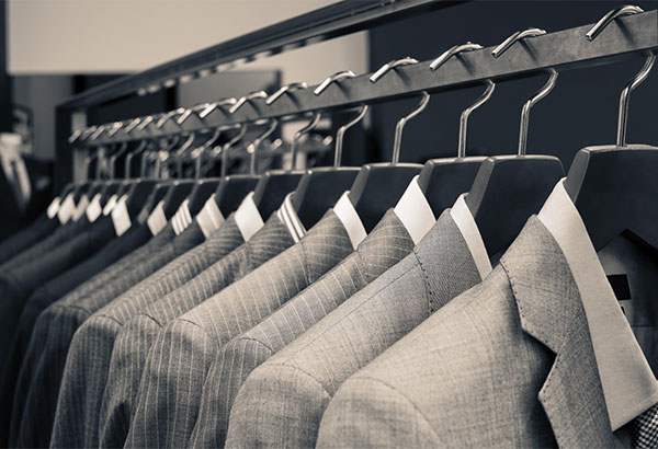 rack with suits by profashionals